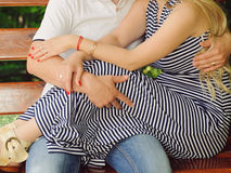 Couple Sitting on Wooden Bench Royalty Free Stock Image