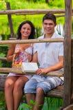 A couple sitting on wooden bridge Stock Photos
