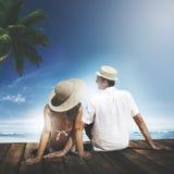 Couple Sitting Wooden Floor Beach Sky Honeymoon Concept.  Royalty Free Stock Photo