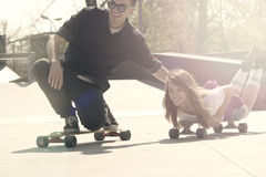 Couple in skate park Stock Images