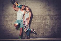 Couple with skateboard  outdoors Stock Image