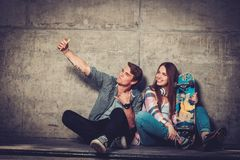 Couple with skateboard  taking selfie Stock Images