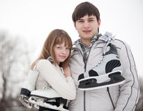 Couple with skates Stock Images