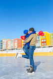 Couple skating hugging balloons in the shape of heart Stock Photography
