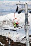 Couple on ski elevator Stock Photos