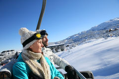 Couple on ski holidays mounting to the top Royalty Free Stock Photo