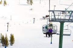 Couple on Ski Lift Stock Image