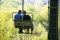 Couple on a ski lift in summer Stock Photos