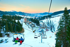 Couple at ski resort. Aerial view from the sky lift on Bukovel - famous Ukrainian ski resort Stock Photos