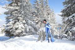 Couple with ski in the winter landscape Royalty Free Stock Images