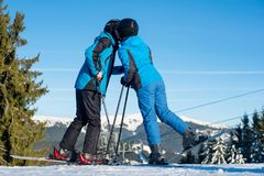 Couple skiers kissing on mountain top at sunny day Royalty Free Stock Photo