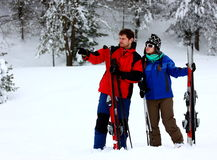 Couple on a skiing holiday. Couple looking at a winter forest before go out skiing Stock Photos