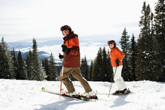 Couple Skiing on Mountain Slope Stock Photography