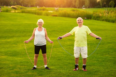 Couple with skipping ropes outdoor Stock Photo