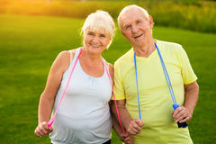 Couple with skipping ropes outdoors. Stock Photo