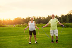 Couple with skipping ropes. Stock Images