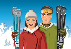 Couple with skis in the mountain Stock Photos