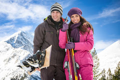 Couple with skis in snow Royalty Free Stock Image