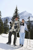 Couple With Skis Standing On Slope Royalty Free Stock Images