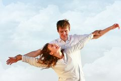 Couple on sky background Royalty Free Stock Image