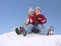 Couple on sled royalty free stock photos