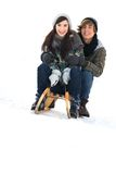 Couple on sled. Young couple on sled in snow Stock Image