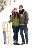Couple with sled Stock Images
