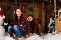 Couple with Sled Outdoors in Winter at Cabin Stock Photos