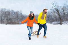 Couple with sled in snow Stock Image