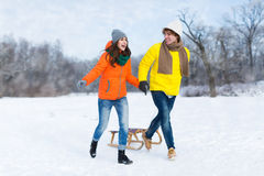 Couple with sled in snow Royalty Free Stock Image