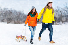 Couple with sled in snow Royalty Free Stock Photography