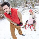 Couple sledding in winter with sled Stock Photography