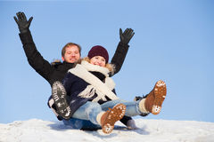 Couple sledging Royalty Free Stock Photo