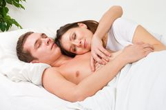 Couple sleep in the bed. And and smile in home interior Royalty Free Stock Photo