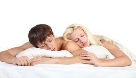A couple sleep in a bed Stock Image