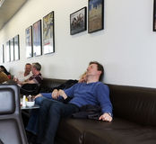 Couple sleep in a cafe. Couple doze off in the members' room of Tate Modern in Bankside, London royalty free stock image