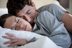 Couple sleeping. Relaxed couple sleeping at home Stock Photography