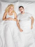 couple sleeping in a bed Stock Image
