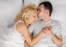 Couple sleeping in a bed Royalty Free Stock Images