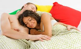 Couple sleeping in the bed Stock Photography