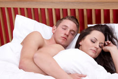 A couple sleeping in bed Stock Image