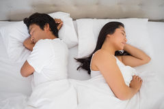 Couple sleeping in bed. At home in bedroom stock photos