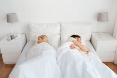 Couple sleeping in bed at home Stock Image