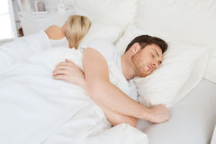 Couple sleeping in bed at home Royalty Free Stock Photography