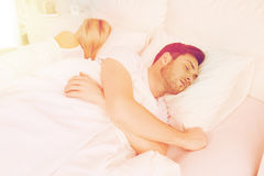 Couple sleeping in bed at home Stock Photos