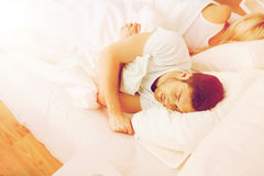 Couple sleeping in bed at home Stock Images