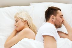 Couple sleeping in bed at home Royalty Free Stock Photo