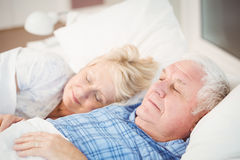 Couple sleeping on bed at home Royalty Free Stock Photography