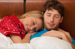 Couple sleeping in bed Stock Photos