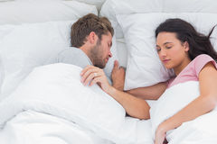 Couple sleeping in bed Royalty Free Stock Photo